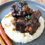 short ribs on mashed potatoes on plate