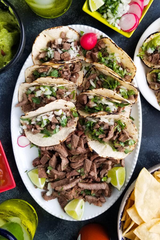 carne asada street tacos on a platter