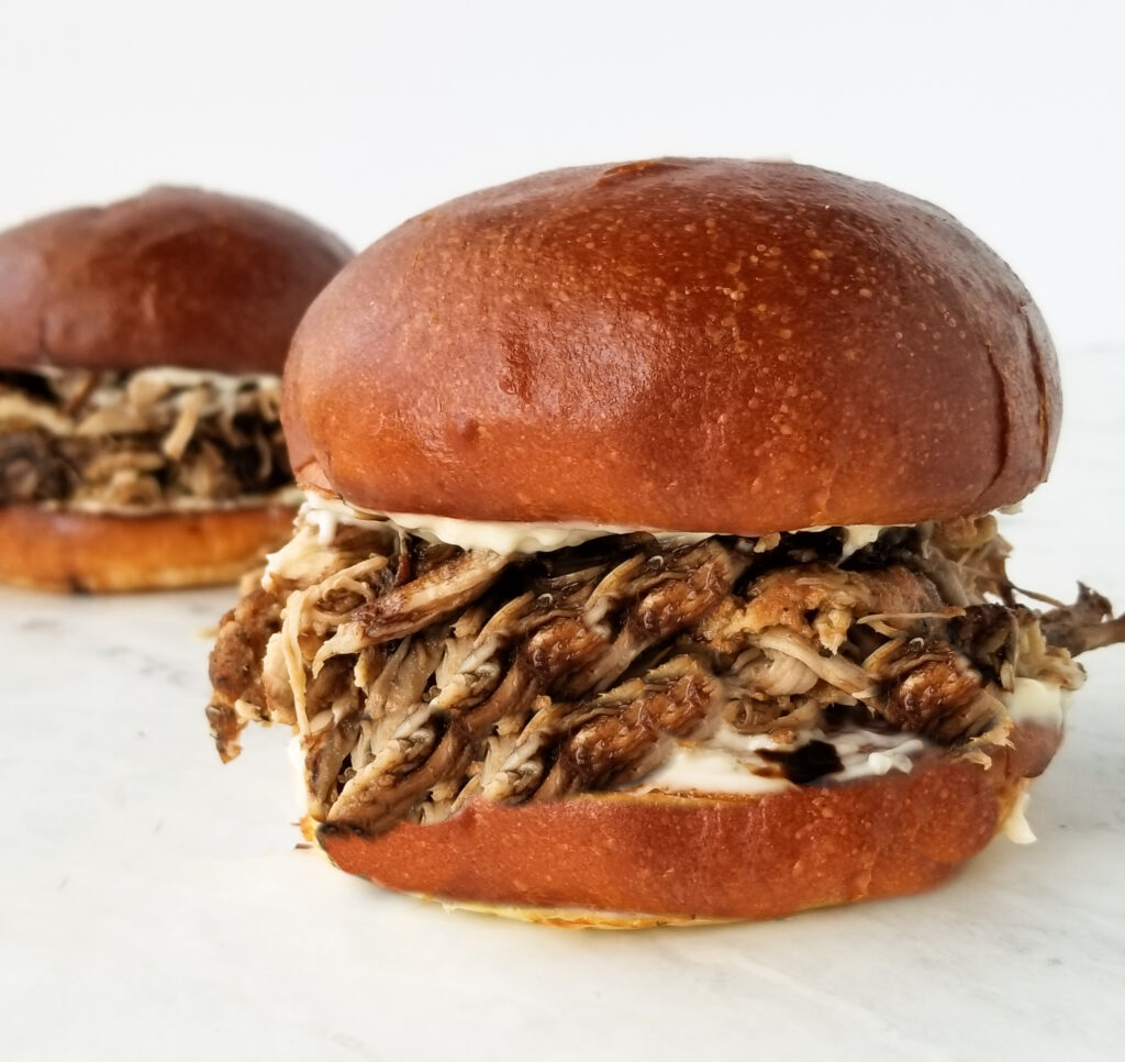 Pulled pork sandwiches on white counter