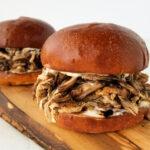 balsamic pullled pork sandwich on wood board