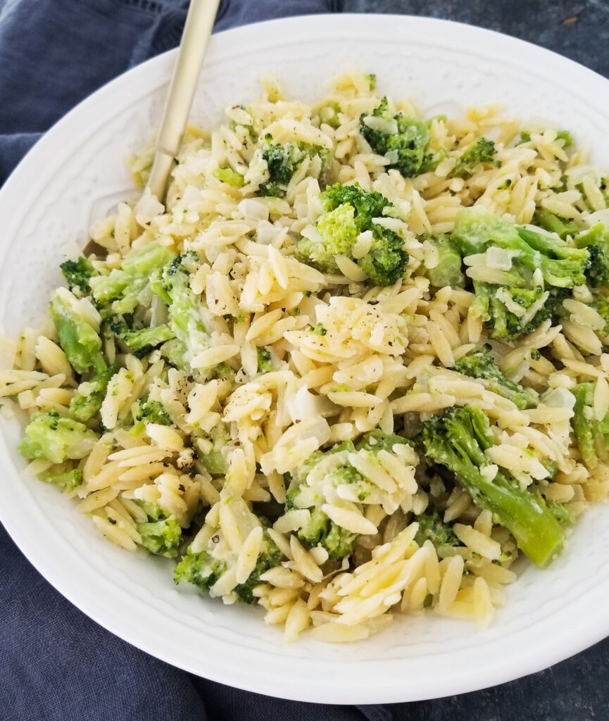 orzo with broccoli in white bowl