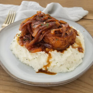 french onion pork chops on mashed potatoes