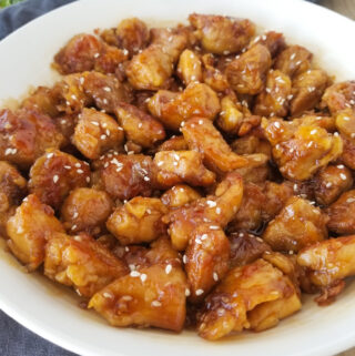 sesame chicken in white bowl