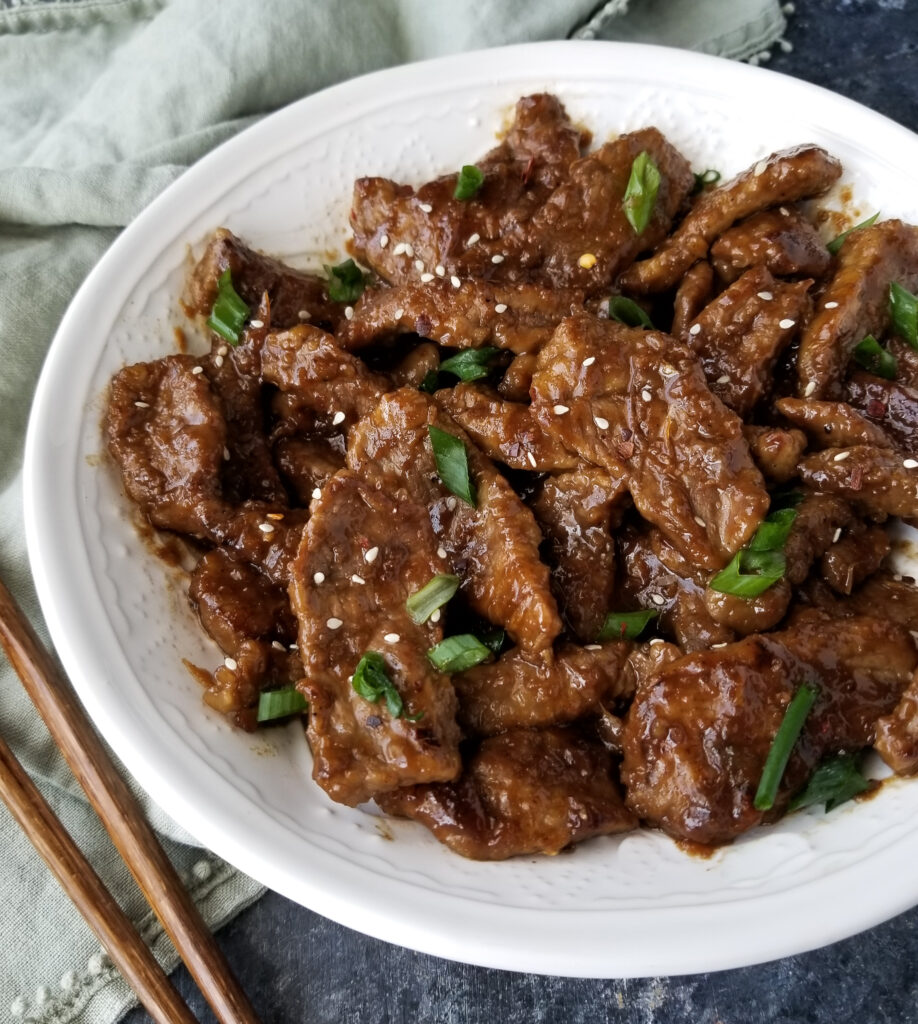 mongolian beef on white bowl