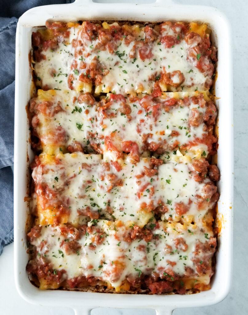 lasagna rolls in white dish
